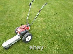 Petrol wheeled strimmer. Honda engine, roughcut mower
